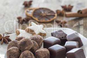 Pralines of Chocolate and marzipan and cinnamon stars