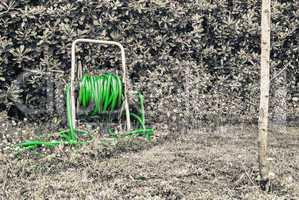 Green water pump in the garden