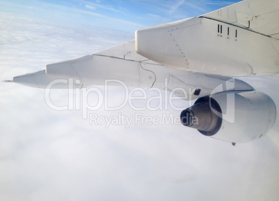 Airplane in flight with Jet Engine detail