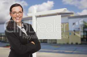 Woman In Front Commercial Building and Blank Real Estate Sign