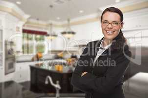 Mixed Race Young Woman Standing in Beautiful Custom Kitchen
