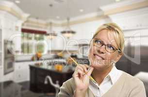 Daydreaming Woman with Pencil Inside Beautiful Custom Kitchen