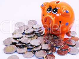 Bunch of coins and piggy bank