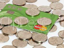 Bunch of coins with credit card