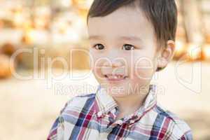 Mixed Race Young Boy Having Fun at the Pumpkin Patch