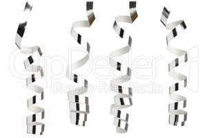 Silver ribbons in front of white background