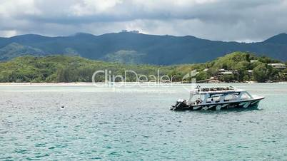 Floating Boat in front of Rainforrest Island // Seychelles HD