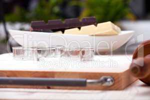 Cookie cutters and white and dark couverture