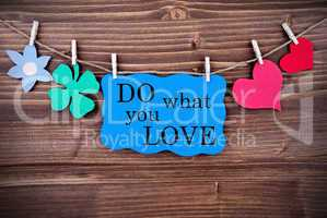 Blue TagWith Phrase Do What You Love On It Hanging on a Line