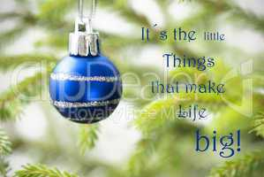 Closeup Of A Blue Christmas Ball With Life Quote