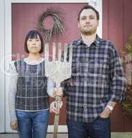 Fun Mixed Race Couple Portrait Simulating the American Gothic Pa