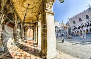 VENICE - APRIL 7, 2014: Tourists enjoy Saint Mark Square on a be