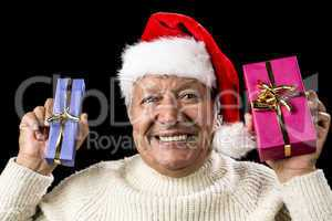 Euphoric Old Man With Two Presents And Santa Hat
