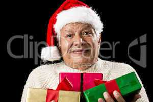 Puzzled Old Gentleman Carrying Three Wrapped Gifts