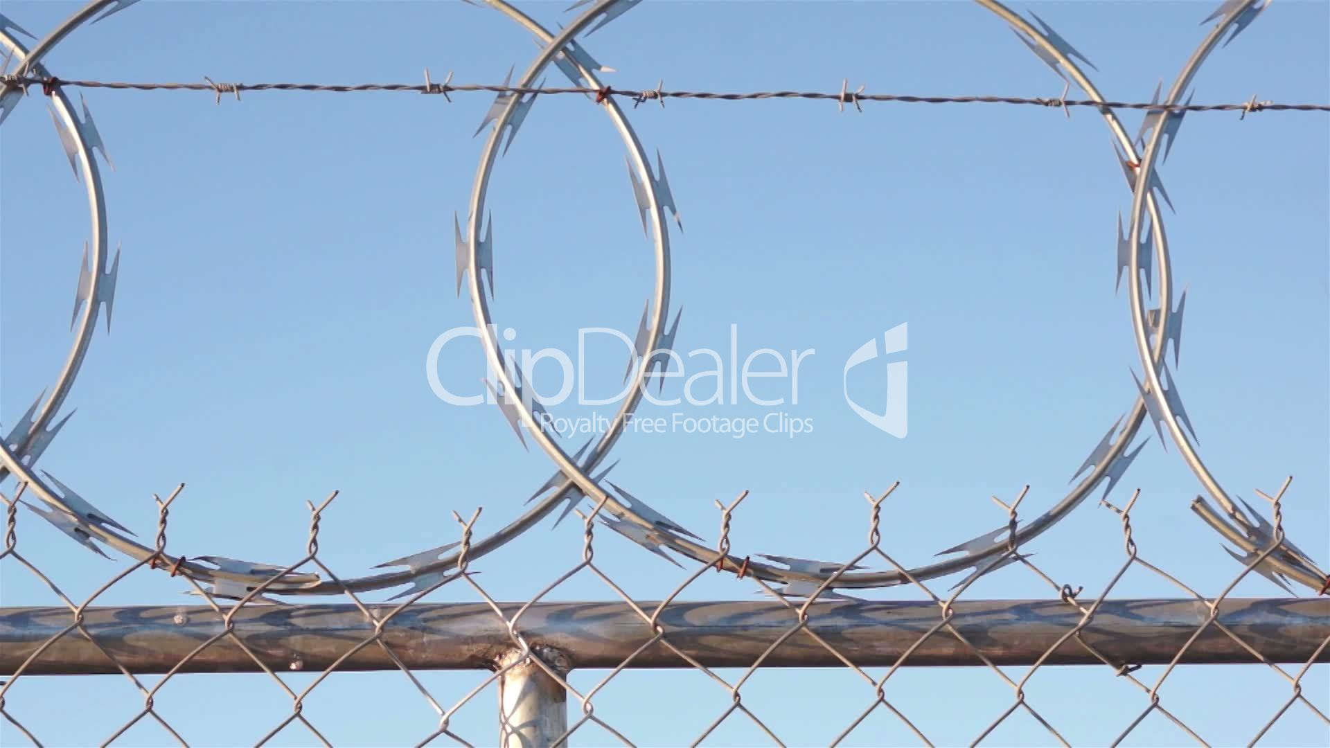 Man Climbing Razor Wire Fence: Royalty-free video and stock footage
