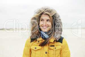Woman in winter on the beach