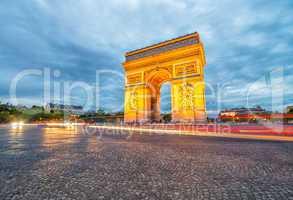 Triumph Arc with city traffic at night, Paris