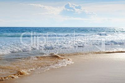 seascape, sand beach and blue sky