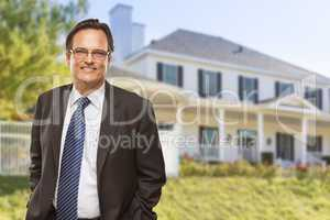 Attractive Businessman In Front of Nice Residential Home