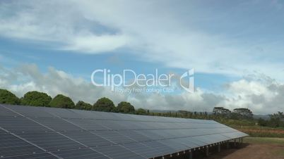 solar panels power plant  in hawaii driving shot