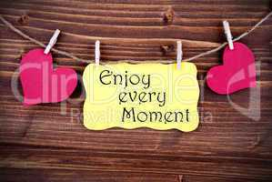 Yellow Lable Saying Enjoy Every Moment