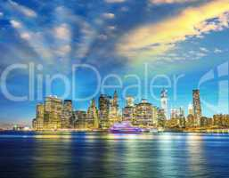Amazing Manhattan skyline from Brooklyn after sunset with river
