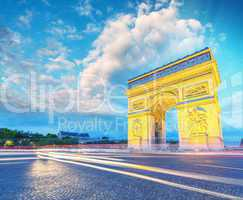 Amazing sunset view of Triumph Arc in Paris with Etoile Roundabo