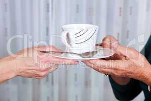 Hands holding cup