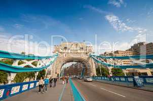 LONDON - AUG 28: Tourists walk along Tower Bridge in the United