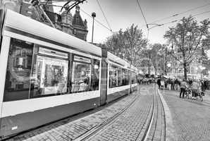 AMSTERDAM - APR 30: Tram running in the city centre amongst pede