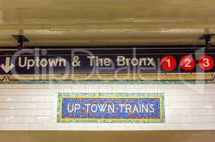 Uptown and The Bronx subway sign in New York City