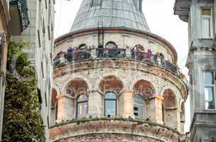 Galata Tower framed by ancient buildings - Istanbul, Turkey