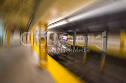 Blurred scene of fast moving train in Manhattan subway - New Yor