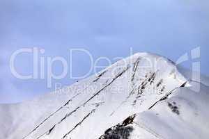 Off-piste snowy slope in morning