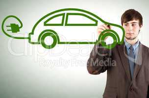 Young man draws electric car