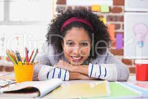 Portrait of female interior designer at desk