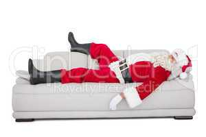 Santa claus sleeping on the couch