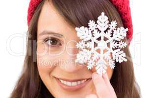 Festive brunette holding snowflake decoration