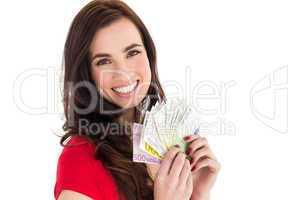 Happy brunette holding her cash money