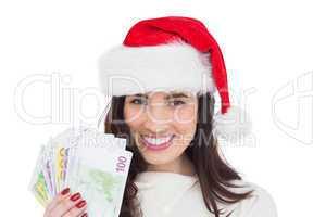 Happy brunette holding her cash