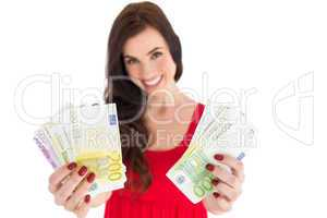 Cheerful brunette showing her cash money