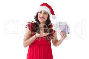 Festive brunette presenting her cash
