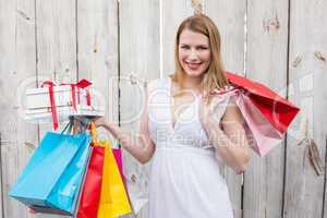 Elegant blonde with shopping bags and gifts