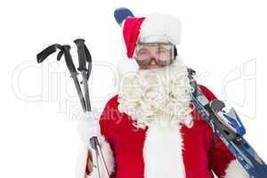 Happy santa posing with ski and ski poles