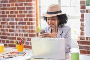 Interior designer text messaging in office
