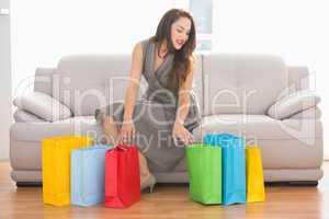 Elegant brunette looking in shopping bag