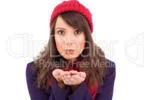 Festive brunette blowing over hands
