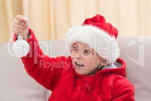 Festive little boy holding a bauble