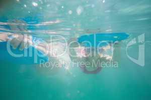 Cute kids swimming underwater in pool