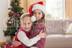 Festive siblings smiling at camera